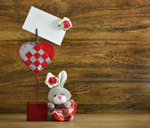 Funny rabbit with card holder — 图库照片