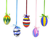 Colorful Easter eggs on lace with bows — Stock Photo