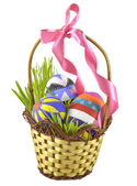 Easter eggs in basket with bow — Stock Photo