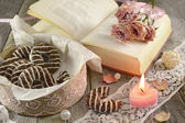Poem book with heart-shaped candle — Stock Photo