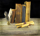 Shabby books with scrolls — Stock Photo