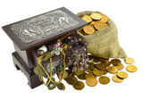 Jewelry in casket and coins in bag — Stock Photo
