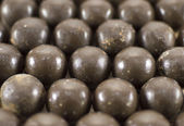 Round chocolate candies background — Stockfoto