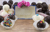 Fancy chocolate candies with greeting card and decorations — Stock Photo