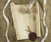 Paper scroll, bottle and white rope — Stock Photo