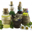 Glass bottles with healing herbs — Stock Photo