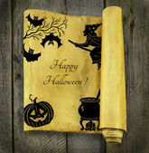 Paper scroll with Halloween silhouettes — Stock Photo