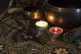 Tibet bowls with candles — Stock Photo
