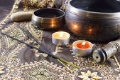 Tibet bowls and candles — Stock Photo