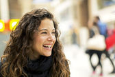 Attractive young woman smiling towards something or someone off camera. Happy positive lifestyle concept — Stock Photo