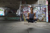 Young Asian Man levitating whilst in meditation — Fotografia Stock
