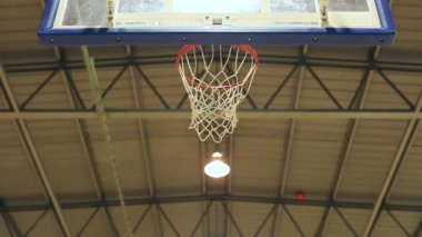 Basketball point being scored from a long range jump shot as the ball passes through the net cleanly — Stock Video