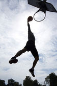 Basketball player slam dunk silhouette — Stock Photo