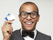Geek holding condoms, sexual health concept — Stock Photo