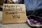 Homeless man sleeping on the streets at Christmas — Stock Photo