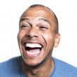 Portrait of a mixed race man laughing hysterically at something — Stock Photo #51154889
