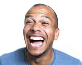 Portrait of a mixed race man laughing hysterically at something — Stock Photo