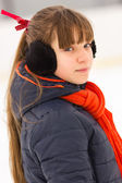 Winter girl with black ear warmers caps — Stockfoto