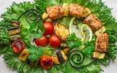 Skewers of salmon and vegetables — Stock Photo