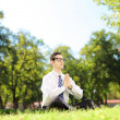 Businessman doing yoga exercise — Stock Photo