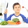 Boy eating healthy meal — Stock Photo
