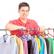 Guy on hang rail full of clothes — Stock Photo #45855203
