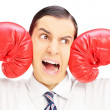 Young man punched by red boxing gloves — Stock Photo #45855225