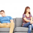 Sad couple on sofa after an argument — Stock Photo #45857117