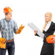 Manual worker having conversation with architect — Stock Photo #45857143