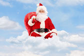 Santa Claus with bag and flying — Stock Photo