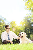 Man with dog in park — Stock Photo