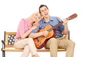 Guy playing guitar to his girlfriend — Stock Photo