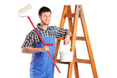 Worker holding paint roller — Stock Photo