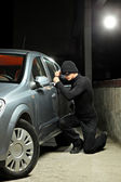 Thief trying to steal car — Stock Photo