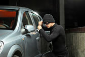 Thief trying to steal autobmobile — Stock Photo