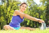 女运动员对运动垫 — 图库照片