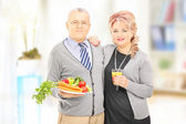 Couple holding healthy food — Stock Photo