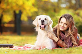 Female lying with her dog — Foto de Stock