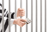 Man in jail giving bribe — Stock Photo