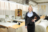 Female standing inside textile factory — Stock Photo