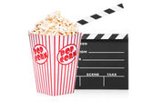 Open movie clap and popcorn box — Stock Photo