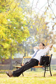 Businessman relaxing in a park — Stock Photo