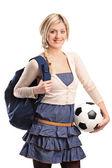 Female student holding football — Stock Photo