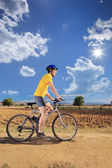 Male bicyclist riding bike — Stock Photo
