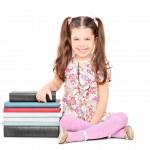 Girl sitting next to books — Stock Photo #45863635