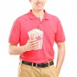 Guy holding popcorn box — Photo #45860637