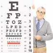 Senior man behind eyesight test — Stock Photo #45862811