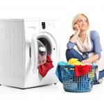 Woman next to washing machine — Stock Photo #45864731