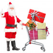 Santa Claus holding cart full of gifts — Stock Photo