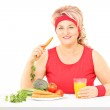 Woman eating vegetables — Stock Photo #45865189